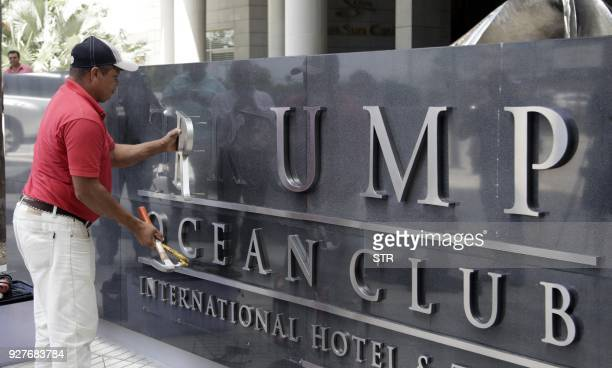 A worker removes the Trump sign letters from outside the hotel in Panama City on March 5 2018 The new owner of the luxury hotel Trump in Panama said...