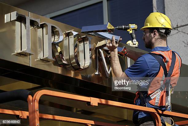 A worker removes the words 'Trump Place' from the 160 Riverside Place residential building in New York US on Wednesday Nov 16 2016 Donald Trump's...
