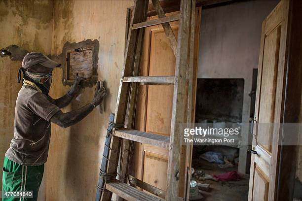 A worker renovates a house as people come back to the land to rebuild in an area that used to be a high security zone recently it was released back...