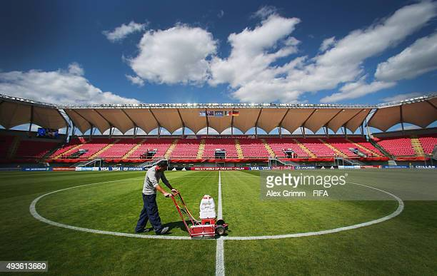 A worker repaints the lines of the pitch prior to the FIFA U17 World Cup Chile 2015 Group C match between Australia and Mexico at Estadio Nelson...