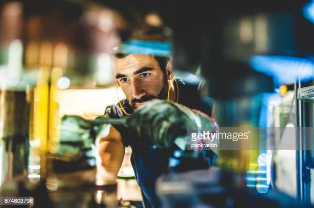 worker repair cold forging machine - making stock pictures, royalty-free photos & images