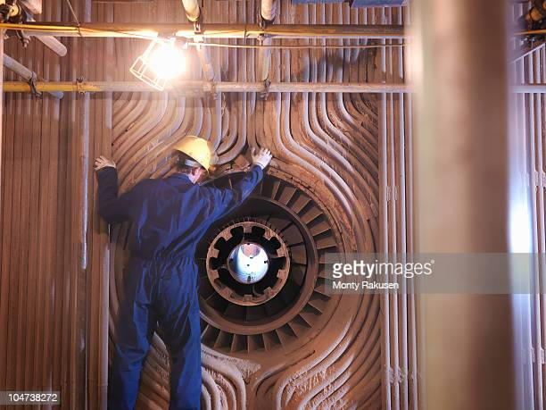 Worker repairing furnace