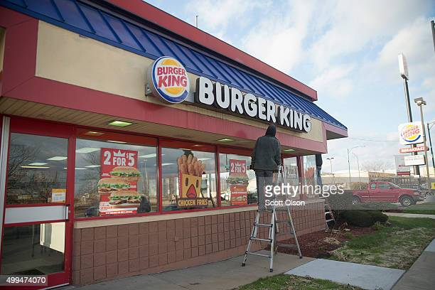 A worker repairs a sign on a Burger King restaurant on the city's Southwest side on December 1 2015 in Chicago Illinois People have accused Chicago...