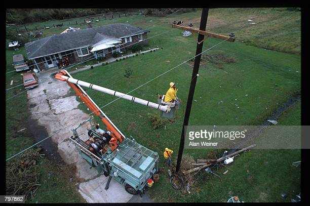 A worker repairs a telephone wire September 27 1989 in South Carolina Hugo is ranked as the eleventh most intense hurricane to strike the US this...