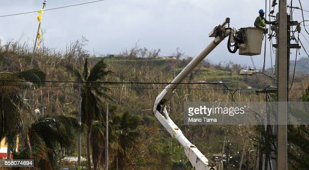 A worker repairs power lines about two weeks after Hurricane Maria swept through the island on October 5 2017 in San Isidro Puerto Rico Puerto Rico...