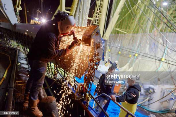 A worker repairs pulse fishing nets in the port of Scheveningen on January 19 2018 in The Hague Netherlands A large majority of members of the...
