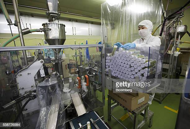 Worker replenishes packaging tubes for Daio Wasabi Farm branded wasabi paste on the production line of the Marui Co. Factory in Azumino, Nagano...