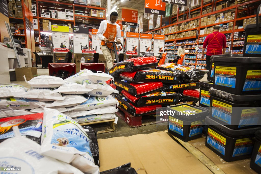 A worker restocks packages of ice melter at Home Depot Inc. store in Boston, Massachusetts, U.S., on Wednesday, Jan. 3, 2018. The worst winter storm of the season has already knocked out power and canceled more than 1,600 flights. Next it threatens to bring more snow, ice and cold from Florida to Nova Scotia, including New York and Boston. Photographer: Adam Glanzman/Bloomberg via Getty Images