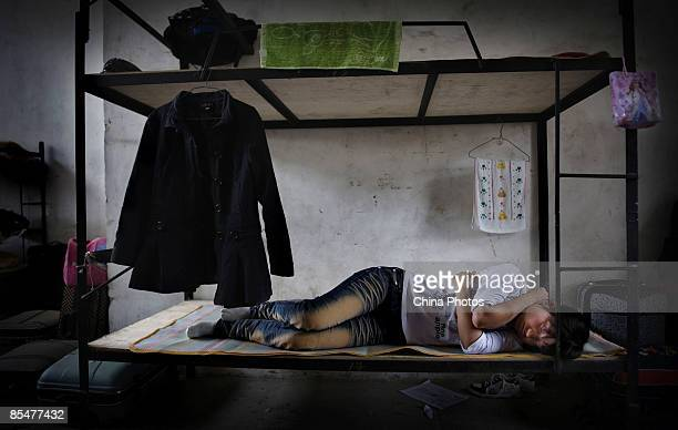 A worker rests at the Shenzhen Quanshun Human Resources Co Ltd on February 26 2009 in Shenzhen Guangdong Province China The company which was...