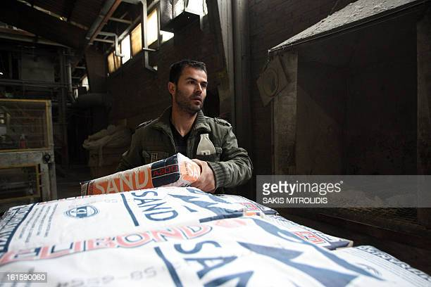 A worker returns to work on 12 February 2013 for the first day of production under workers' control at the Viomichaniki Metalleutiki factory in...