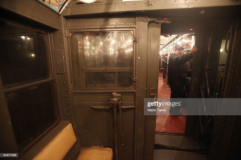 A worker rides an antique subway train during a 'Vintage Tea Party' hosted by Levy's Unique New York tour group December 13, 2009 in New York City. New York City Transit is running a special subway train with cars in service from the 1930's-1970's every Sunday this month from Manhattan to Queens complete with ceiling fans and wicker seats.