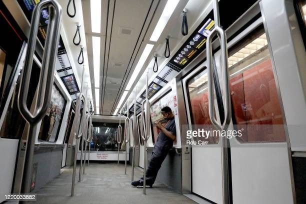 A worker rides the tram between terminals at HartsfieldJackson Atlanta International Airport on April 20 2020 in Atlanta Georgia The airline industry...