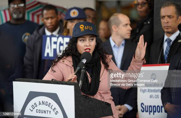 TSA worker Rosa Guzman speaks at a press conference for the American Federation of Government Employees the union that represents TSA officers in...