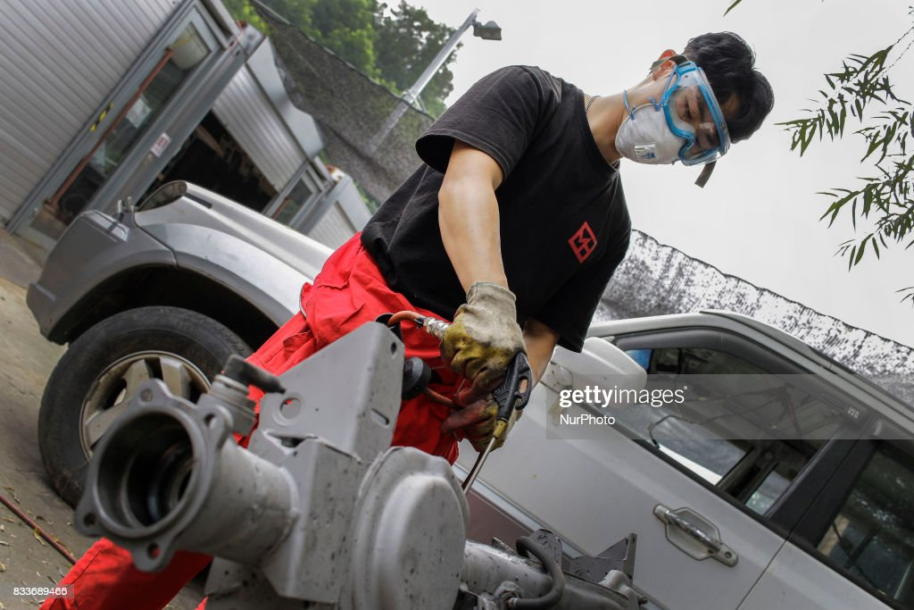 """Worker rust remove use high pressure air at mohenic garages yard in Paju, South Korea. A 20-year-old beat up Hyundai SUV isn't anyone's idea of a dream car. But used Hyundai Gallopers, priced between $2,000 to $3,000 at second-hand car markets, are making a comeback , reborn as upwards $80,000 luxury vehicles at the hand of former furniture designer Henie Kim. Kim is now the CEO of Mohenic Garages, a car rebuilding company based in Paju has transformed the boxy classic into one of South Korea's most highly-desired cars. """"As a former designer, I wanted make everything perfect."""" The remade """"Mohenic G"""", as they're known, take their design cues from the 1990s and come in a variety of custom colors from """"mint racing green"""" to """"midnight cerulean blue"""". Demand for the """"Mohenic G"""" has steadily risen, and the waitlist is long. Since 2013, only 43 cars have been rebuilt and 48 customers are on a waiting list. Production is slow though since the company expanded, they're able to produce 30 cars a year, or about 2 cars a month. A team of two dozen workers transform each car in a meticulous process that includes prying the car cabin from its frame, sanding, removing corrosive substances, polishing and painting."""