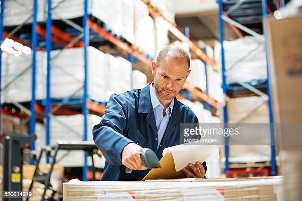 Worker scanning barcode at warehouse