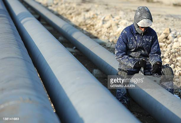 A worker scrapes a pipe on the Martigues's petrochemical site on February 3 southern France The cold snap in Europe will last until the end of the...