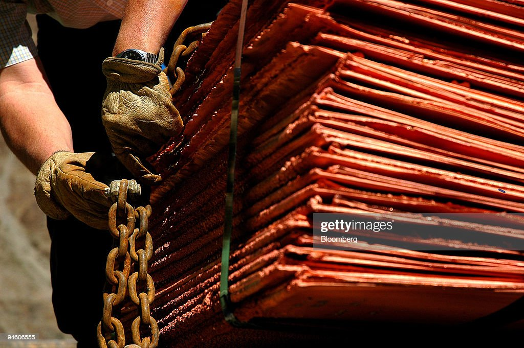 A worker secures copper plates before they are shipped at th : News Photo