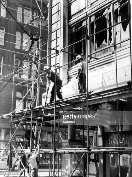 Worker seen erecting scaffolding after the fire at Henderson's department store in Church Street 22nd June 1960