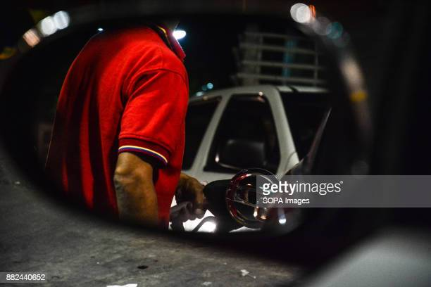 A worker seen filling up a car with petrol at a petrol station The future of the oil subsidiary in Venezuela is uncertain after the country accusing...