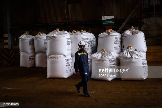 Worker seen with a face mask next to nickel bags at the PT Vale Indonesia nickel plant. Nickel mining by the PT Vale Indonesia, a nickel plant in...
