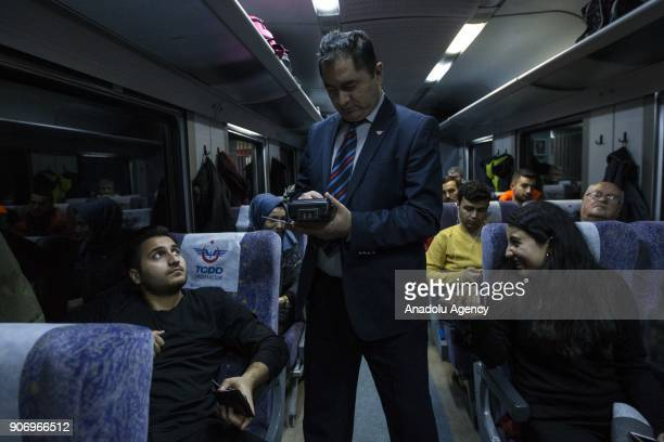A worker sell tickets to travelers on the Eastern Express which travels from Ankara to Kars in Ankara Turkey on January 13 2018 With the starting of...