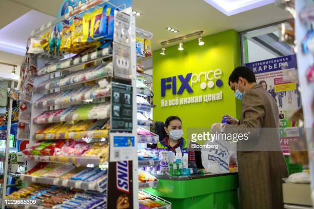Worker serves a customer at the check-out till inside a Fix Price discount store in Moscow, Russia, on Friday, Oct. 30, 2020. Russias biggest...