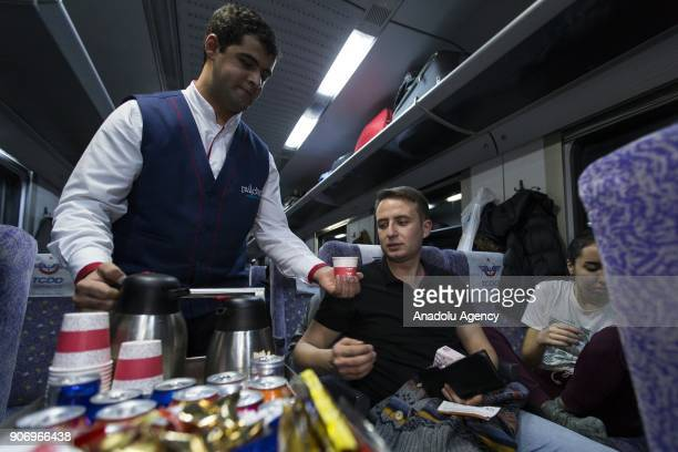 A worker serves food to travelers on the Eastern Express which travels from Ankara to Kars in Ankara Turkey on January 13 2018 With the starting of...