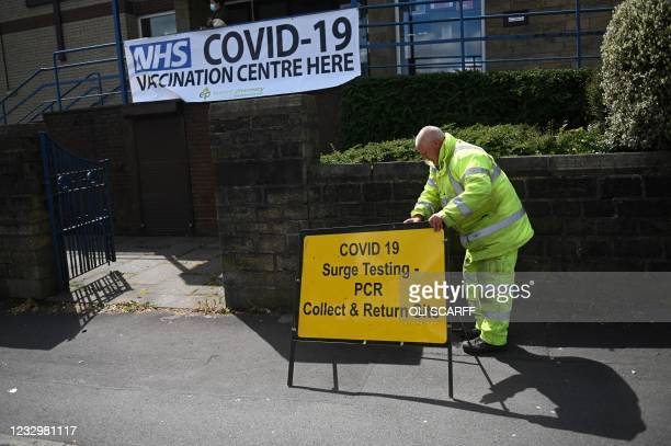 Worker sets outs a sign for a Covid-19 PCR Surge testing site, and vaccination centre, at the United Reformed Church in Blackburn, northwest England...