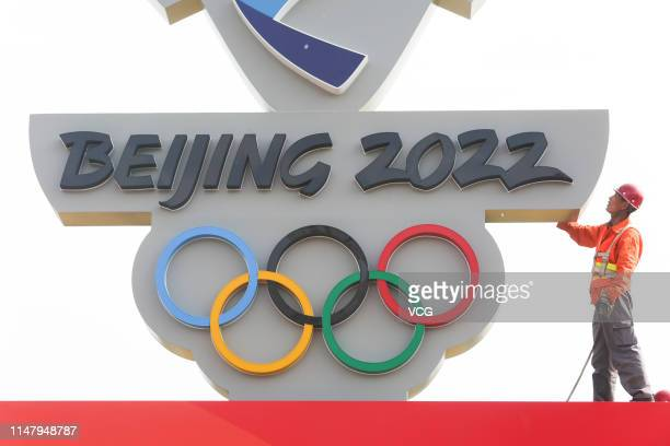 Worker sets up a countdown board reading 'Beijing 2022' ahead of the 1,000-day countdown to 2022 Winter Olympics on May 8, 2019 in Zhangjiakou, Hebei...
