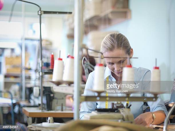Worker sewing in clothing factory