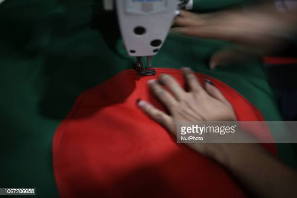 A worker sewing national flag of Bangladesh ahead of 16 December victory day in Dhaka Bangladesh on December 1 2018 The 11th parliamentary election...