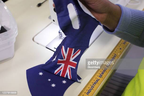 Worker sews a face mask featuring the Australian flag at a Coleman Group factory in Sydney, New South Wales, Australia, on Tuesday, Aug.4, 2020. New...