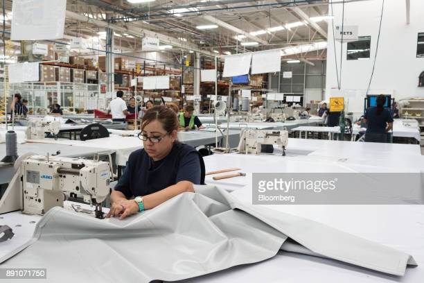 A worker sews material together while assembling aircraft cargo nets at the Tighitco Inc manufacturing facility in San Luis Potosi Mexico on Thursday...