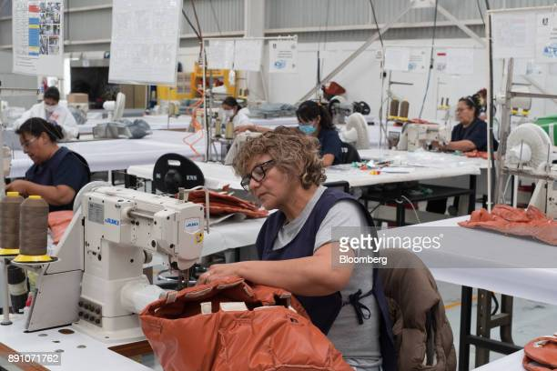A worker sews material while assembly an aircraft insulation blanket at the Tighitco Inc manufacturing facility in San Luis Potosi Mexico on Thursday...