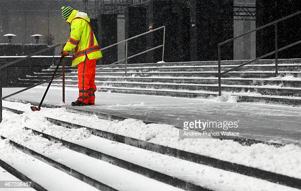 TORONTO ON FEBRUARY 5 A worker shovels snow from steps in Toronto's Financial District February 5 2014 A special weather statement remains in effect...