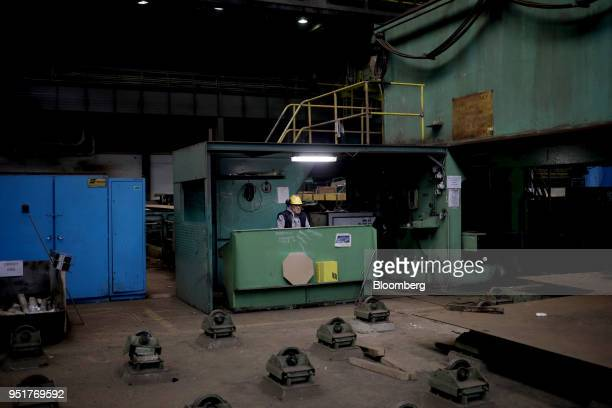Worker sits in a factory machinery control room at the GSG Towers Sp. Z o.o. Factory, a unit of the Gdansk Shipyard Group, in Gdansk, Poland, on...