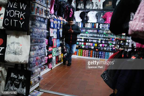 Worker sits in an empty gift shop in New York's Chinatown on February 13, 2020 in New York City. Gregg Bishop, commissioner of the Department of...