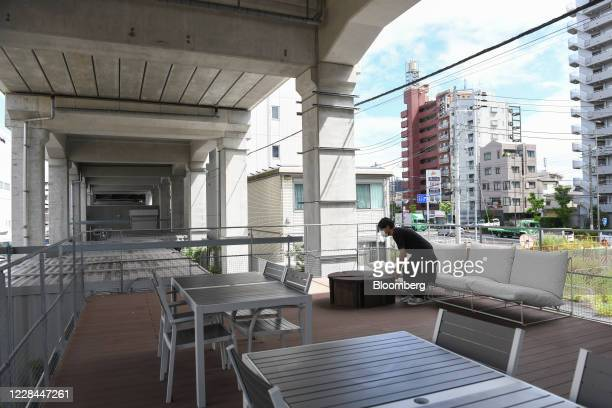 Worker sits in the rest area of the Koca co-working space built under railway tracks in Tokyo, Japan, on Thursday, Sept. 3, 2020. In Tokyo, the...