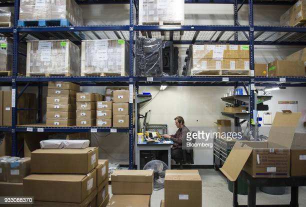 A worker sits in the shipping and packing area of the Aleph Objects Inc LulzBot 3D printers production facility in Loveland Colorado US on Wednesday...