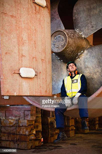 worker sitting in propeller on dry dock - resting stock pictures, royalty-free photos & images