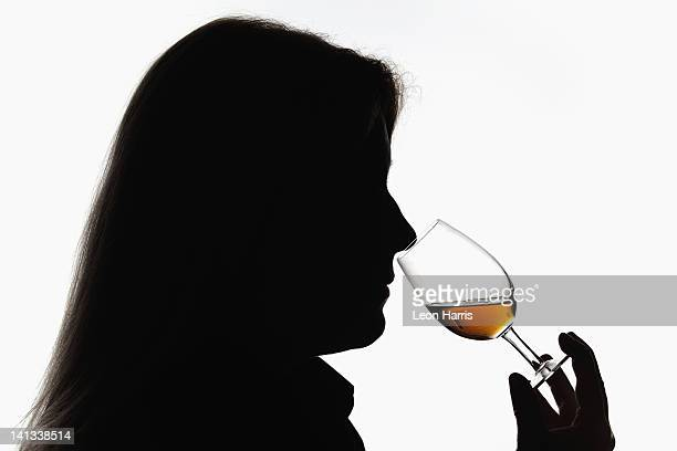 worker smelling whisky in distillery - scotch whiskey stock pictures, royalty-free photos & images