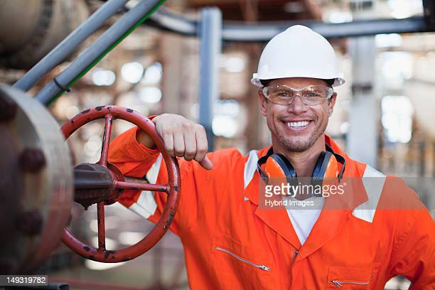 Worker smiling at oil refinery
