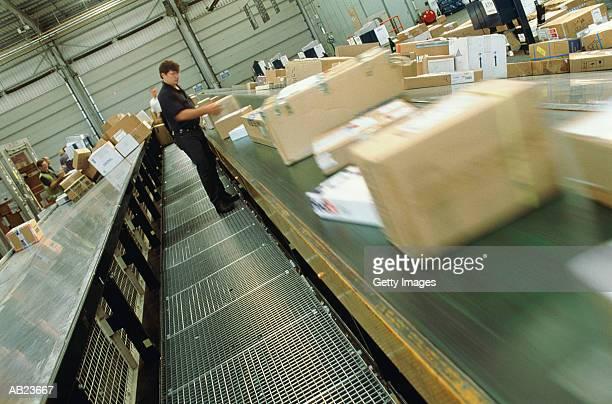 Worker sorting airmail