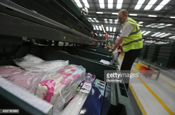 A worker sorts customer 'click and collect' orders into crates destined for John Lewis stores at the John Lewis Plc semiautomated distribution centre...
