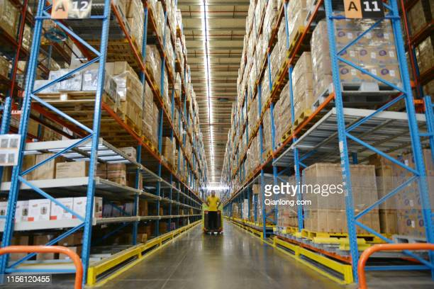 Worker sorts express boxes at a logistic base of Suning.com Co., Ltd. Before the upcoming 618 Shopping Festival on June 15, 2019 in Nanjing, Jiangsu...