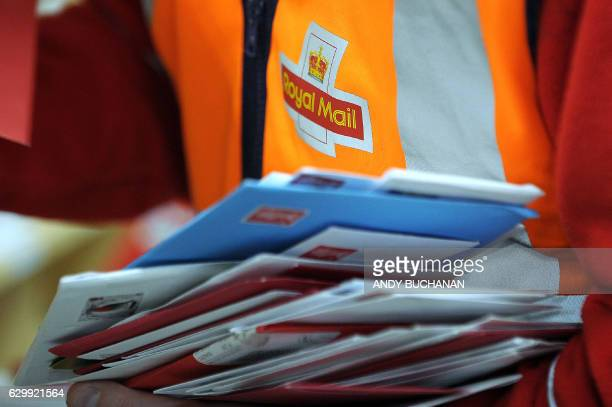 Worker sorts mail at the Royal Mail Distribution centre in Glasgow in what is traditionally the busiest day of the year for mail in the run up to...