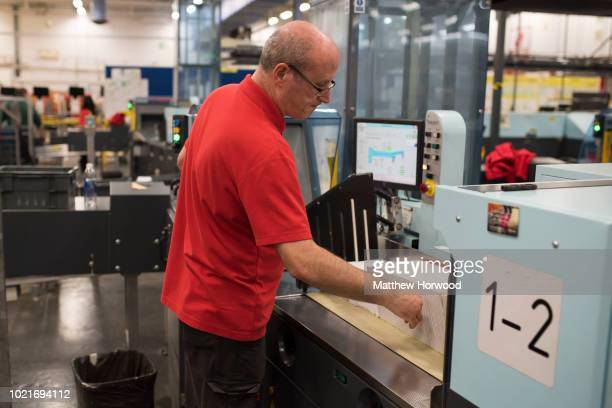 A worker sorts mail at the Royal Mail sorting office on Penarth Road on May 15 2017 in Cardiff United Kingdom