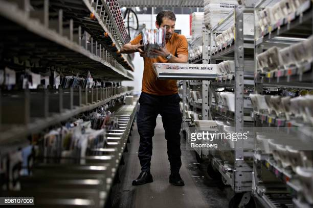 A worker sorts mail into trays at the United States Postal Service Suburban processing and distribution center in Gaithersburg Maryland US on Tuesday...