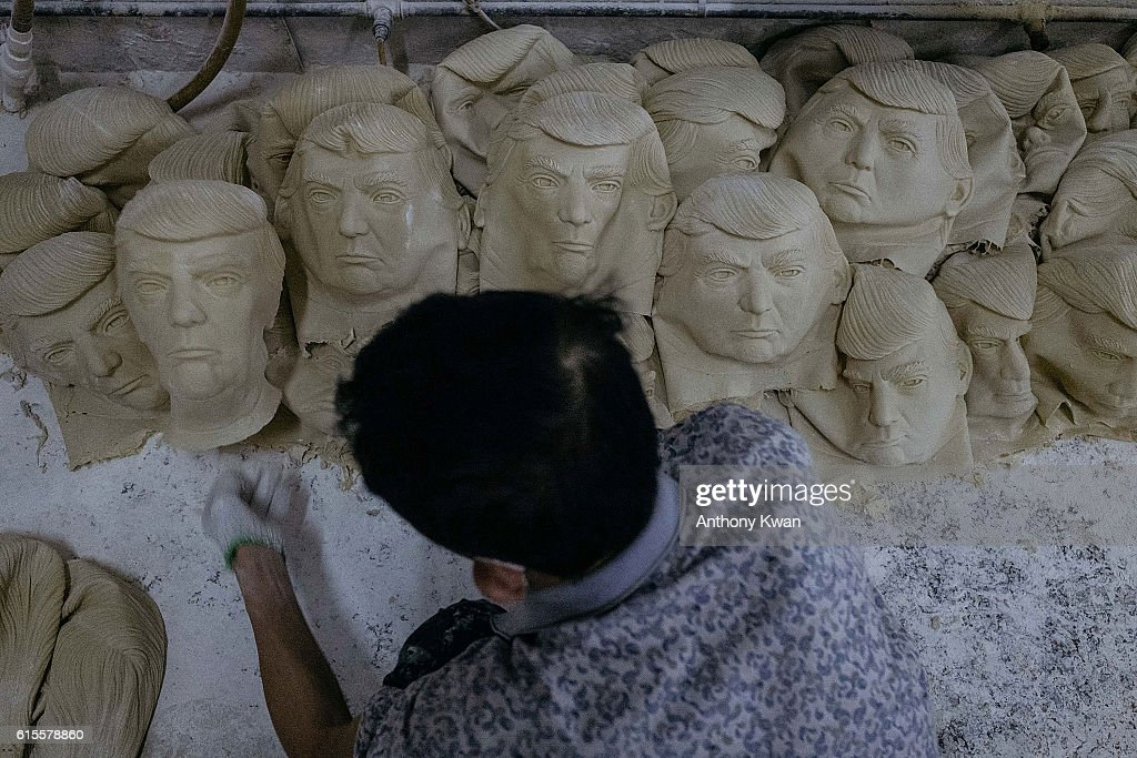 A worker sorts out masks of Donald Trump on the floor at the Shenzhen Lanbingcai Latex Crafts Factory on October 18, 2016 in Shenzhen, China. Shenzhen Lanbingcai Latex Crafts Factory, located in the industrial area of Shenzhen with 20 to 30 employees, produces all sort of Halloween and party costumes and masks. It runs a small scale production of Donald Trump masks for local distribution within mainland China costing from 30 Renminbi onwards as the third Presidential Debate 2016 between Donald Trump and Hillary Clinton happens on Thursday. Chinese media have derided the election as a risible variety show in which the candidates' spectacular personal failings have taken precedence over the business of governance.