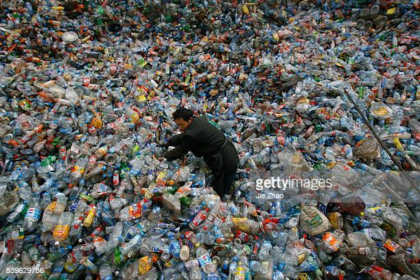 A worker sorts plastic bottles at a recycling centre on the outskirts of Wuhan Hubei province December 1 2009 VCP